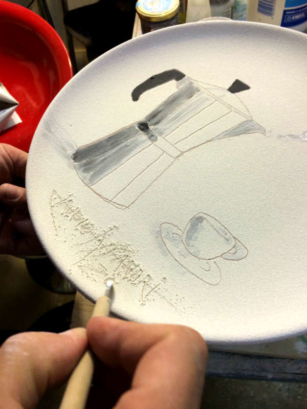 The making of Italian Summers plate Moka Amore. Exclusive ceramic plate by Italian Summers.The signing of the plate by Claudio