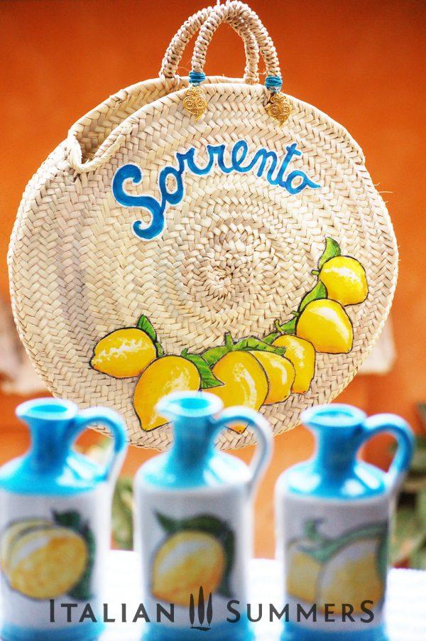 Straw bag Sorrento lemons plus ceramic limoncello bottles vertical